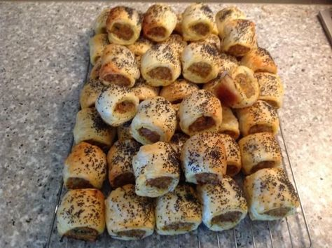 A combination of a few recipes - the secret is to have really cold pastry and use good quality sausage meat.