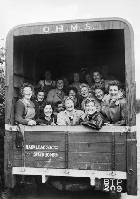 The Women's Land Army (WLA): A group of happy Land Army girls in the back of an OHMS truck, Devon, England.