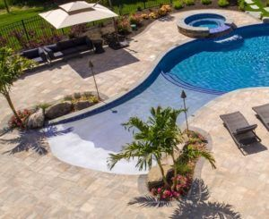 Dip Into Different Types Of In Ground Pools Swimming Pool Designs Pool Designs Beach Entry Pool