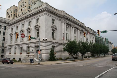 Federal Building and US Courthouse in Wheeling, WV: Selection of the site in 1902 was initially criticized for its lack of visual prominence & its distance from the city center. Shortly after construction, commercial development shifted northwards toward the new building. The construction of the federal building was an important local event for the prosperous industrial city of Wheeling, setting a high standard for architectural excellence.