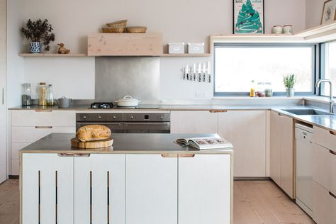 Contemporary eco kitchen, with flat panel plywood cabinetry, stainless steel worktops and a movable centre island.