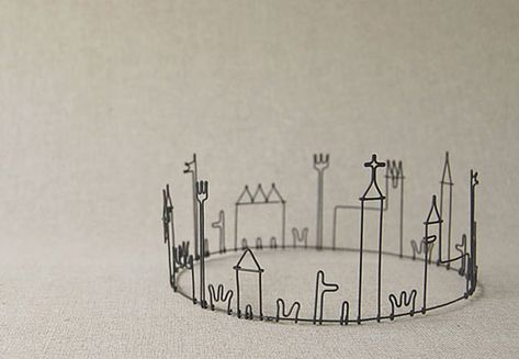 I'm smitten by the intricate wire works of Masao Seki, especially the ones depicting buildings and houses.