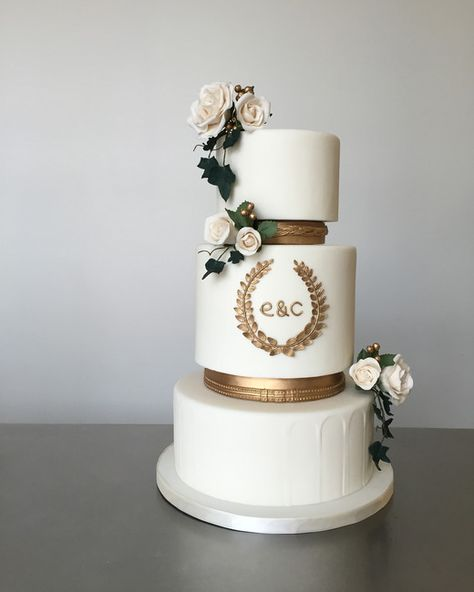 Ancient Greece / Greek themed three-tier wedding cake with gum paste roses, ivy and gold laurel wreath monogram by /xannybakes/