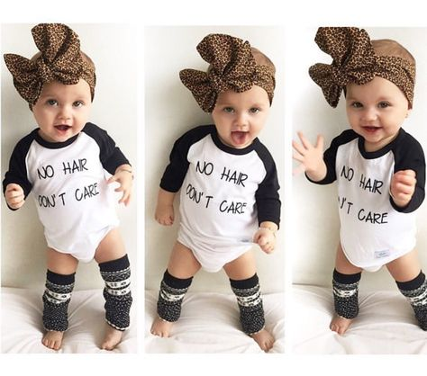 This onesie for the cutie who is bald AF but still totally flawless. | 29 Gifts For The Coolest Baby You Know