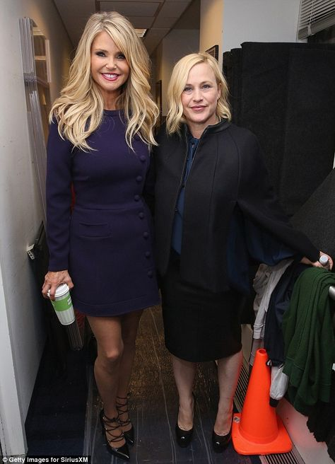 Blonde beauties: The model showed off a thick mane of bouncy blonde tresses as she posed next to actress Patricia Arquette, 47