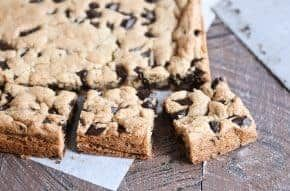 These super soft, chewy chocolate chip cookie bars are easy (one bowl!) and so delicious! The perfect fix for that chocolate chip cookie craving. | melskitchencafe.com #chocolatechipcookiebars #cookiebars #chocolatechipcookies