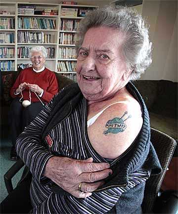 TIGHT KNIT: Metlifecare residents and knitters, Janet Murphy and Gwenda Turfrey, who displays her knitting tattoo.