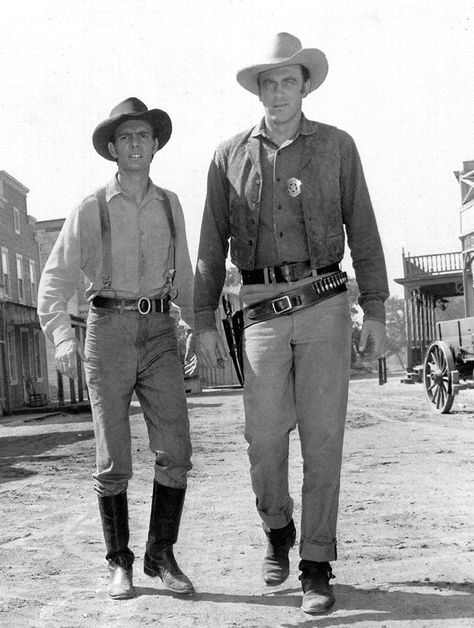 """Dennis Weaver (left) as Chester and James Arness as Marshal Matt Dillon in TV's """"Gunsmoke,"""" seen here on the main street at Melody Ranch in 1956"""