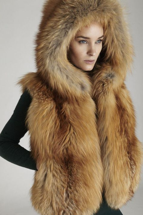 Gold Fox Fur Hooded Vest Silk Lining Hook & Eye Closure Length: Fur Origin: Finland Made in USA Ships in days Professionally clean by fur method