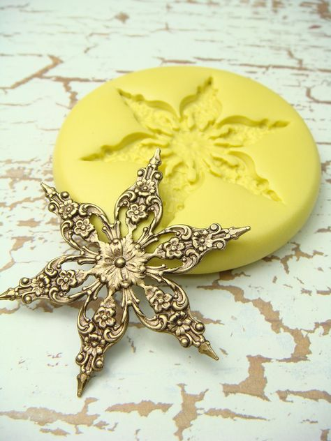 Snowflake (design 2)  - Flexible Silicone Mold - Push Mold, Jewelry Mold, Polymer Clay Mold, Resin Mold, Craft Mold, PMC Mold. $4.99, via Etsy.