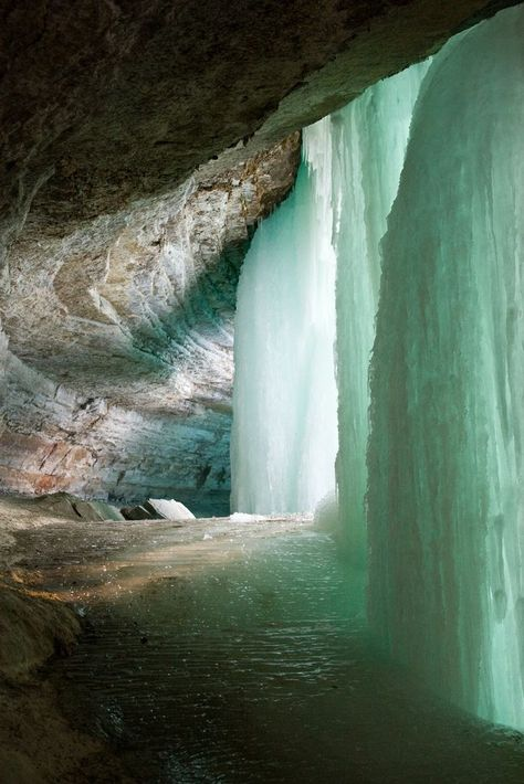 Behind the frozen Minnehaha Falls, a 53-foot waterfall located in Minnehaha Park, Hennepin County, Minnesota, USA:
