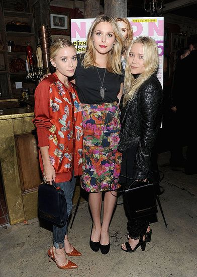 Ashley Olsen, Elizabeth Olsen and Mary- Kate Olsen attend the NYLON & AX Armani Exchange Private Dinner for the October issue with cover star Lizzie Olsen on October 2011 in New York City.