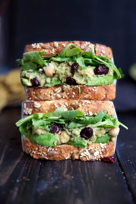 INCREDIBLE vegetarian smashed avocado chickpea salad sandwich. No mayo necessary thanks to the creamy, ripe avocado. Cranberries and lemon give it a nice sweet tang too!