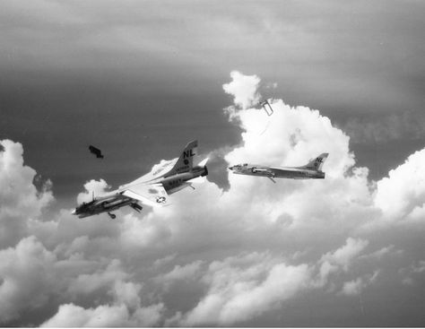 Lt. Jack Terhune successfully ejects from his VF-154 F-8D Crusader near Coralsea 20 miles out at sea after battle damage over North Vietnam 11.10.65
