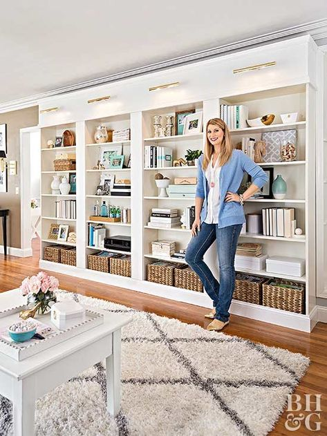 woman in front of built in bookcase shelves