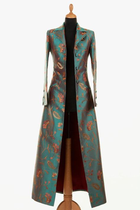 My favourite! This is a stunning ankle length single breasted long silk coat. It is the same style as the Grace Coat with the half belt and revere collar, just longer. No vents. Slit pockets for the silk coat only. Length 57 inches.  Because of the exclusive nature of our designs and with so many