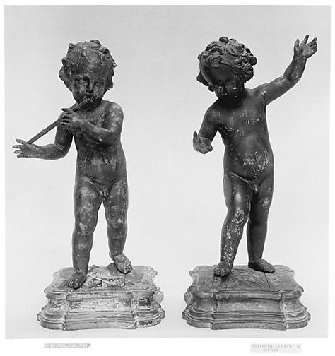 Nude Child Playing a Flute
