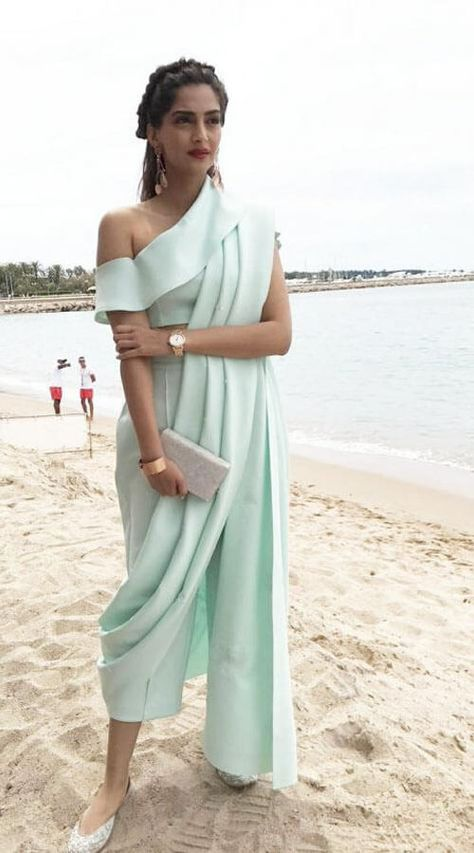 Sonam Kapoor is clicked here on her Day 2 at the Cannes 2017 international film festival. The B-town fashionsta today sported a sea-blue House of Ma.