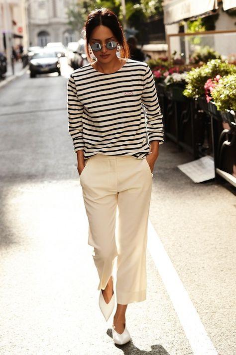 Le Fashion Blog Parisian Style Low Bun Mirrored Round Sunglasses Striped Long Sleeve Shirt Cropped Cream Pants White Pointed Celine Flats Via Gary Pepper