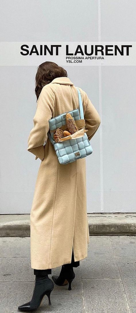 What's the point of carrying around a stylish bag if you can't pack it full of carbs? This icy blue Bottega Veneta Padded Cassette Bag shown on @lauranycol can hold your phone AND your morning bagels. What's not to love?