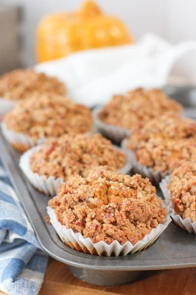 These super delicious Pumpkin Crunch Muffins have double the crunchy topping! Easy to make and freeze wonderfully! #pumpkinmuffin #pumpkinrecipe #easypumpkinmuffin #fallrecipe #pecanrecipes #pumpkinpecan