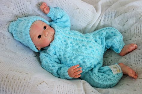 d17aa604e Hand knitted baby boy or girl s romper suit all in one with cables ...