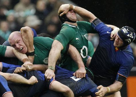 Ireland and France national rugby team members are involved in a scrum during their Six Nations rugby union match at the Stade de France stadium, in Saint Denis, outside Paris.