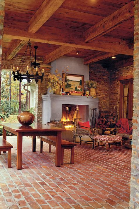 Composed of a brick chimney, mantel, and firebox, this exterior fireplace is covered with stucco. This touch not only distinguishes it from the surrounding brick walls, but it also makes a focal point.