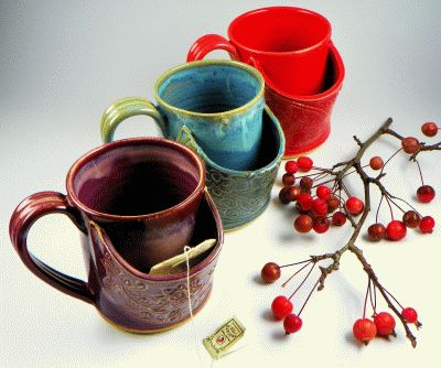 mugs with tea bag slit...love this, just remember to turn the slit ...