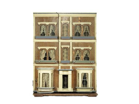 A Large three story painted wooden dolls town house and furniture, English circa 1880