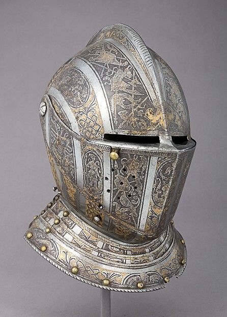 Close Helmet    Armorer:Attributed to Pompeo della Cesa (Italian, Milan, ca. 1537–1610)  Date:ca. 1585  Geography:Milan  Culture:Italian, Milan  Medium:Steel, gold, brass  Dimensions:H. 11 5/8 in. (29.5 cm); W. 9 1/2 in. (24.1 cm); D. 11 in. (27.9 cm); Wt. 5 lb. 14 oz. (2665 g)  Classification:Helmets  Credit Line:Gift of William H. Riggs, 1913  Accession Number:14.25.656