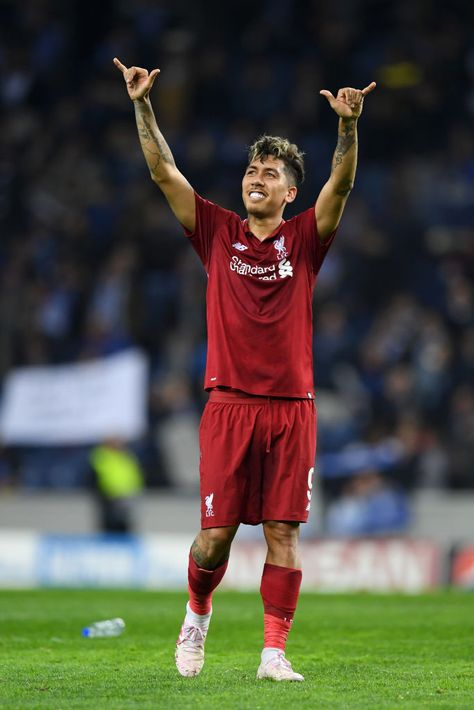 Roberto Firmino of Liverpool celebrates victory after the UEFA...