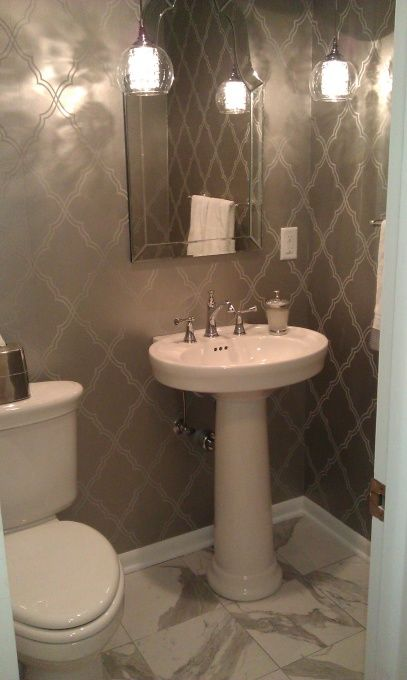 glam small bathroom - love the wallpaper  saw this mirror on clearance at homegoods!