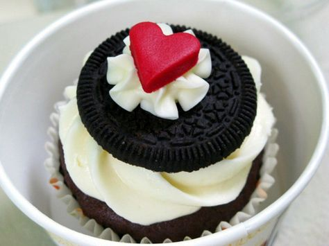 Chocolate boxed cake mix, vanilla frosting, Oreo cookie and a Starburst cut into a heart shape w/ a mini cookie cutter