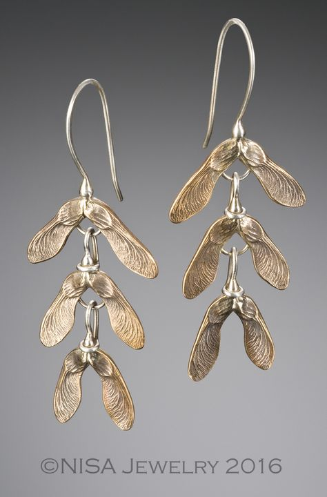 3 tiers of graduated samaras (maple seed pods), handcrafted in bronze, with sterling silver ear wires. These earrings are lightweight and dance around when worn, much as the pods would in nature.