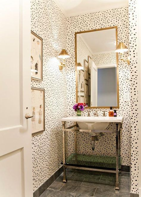15 Incredible Small Bathroom Decorating Ideas - bold black and white spotted  wallpaper styled with a minimalist sink and gold mirror   StyleCaster
