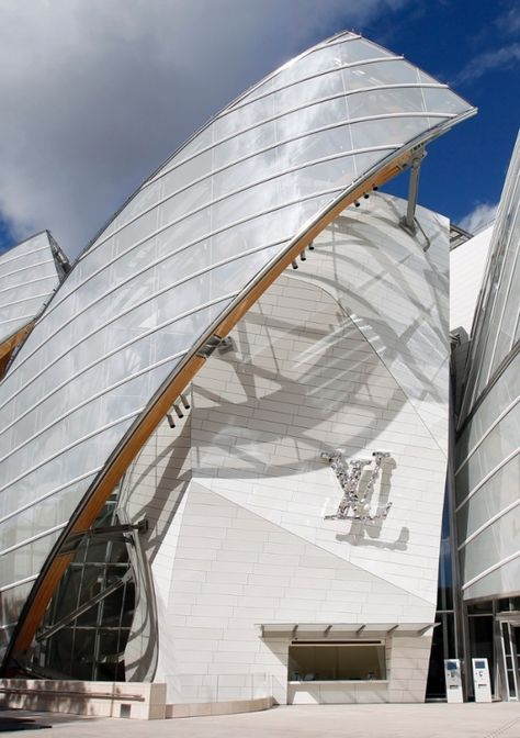 The Fondation Louis Vuitton 'wears like a big diamante brooch the intertwined letters LV'.; Fondation Louis Vuitton, Paris review – everything and the bling from Frank Gehry