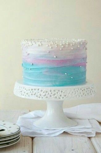Light blue ocean color and a touch of purple or light pink and white icing with ...