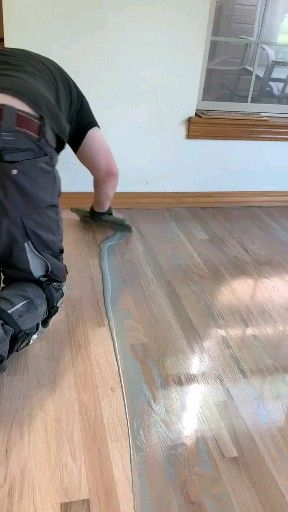 Red oak flooring finished with loba 2k impact oil clay