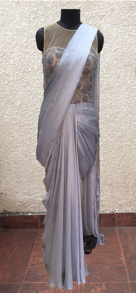 Featuring an Icey blue-grey sari gown (pre stitched sari) in satin georgette with grey bead,bugul and sequins hand work.Care:Dry clean onlyComposition:satin georgette