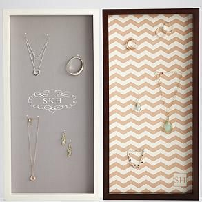 Wall hanging jewelry display case from Red Envelope I bet I could