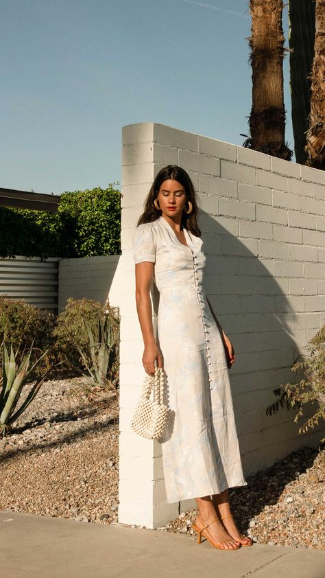 Click to shop outfit + more photos! Sarah Butler of Sarah Styles Seattle wears Equipment Gaetan button front floral midi dress and ROSANTICA Patti beaded tote in Palm Springs Outfit   @sarahchristine