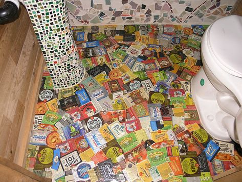 Papier-mâché floor created with beer bottle labels by The Phoenix Commotion.