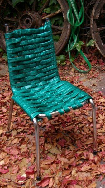 Garden hoses = new chair webbing  Reminds me of the idea of using vintage belts on chairs: exampleshere, here, and here.  If you like the idea of using hoses on chairs, thisearlier Unconsumption postlinks to a tutorial for a different chair webbing look.  (Chair pictured above, via En tu punto; spotted on Pinterest)