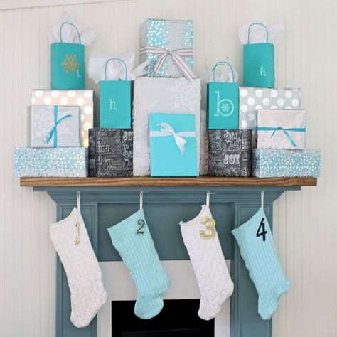 Such an easy way to create a Christmas mantel - just fill it up with gifts! #easyholidayideas