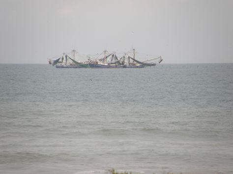 Shrimp Boats taking a break. In front of Beach Island resort in Cocoa Beach Florida. 2012