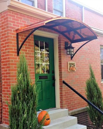 The Copper Eyebrow Awning With The Smith Scrolls In Washington Dc Door Awnings Custom Awnings Awning Over Door