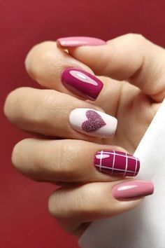 Valentine's nails from golden rhinestones along the edges of a French manicure to minimalist nail sprinkled with red heart accent!