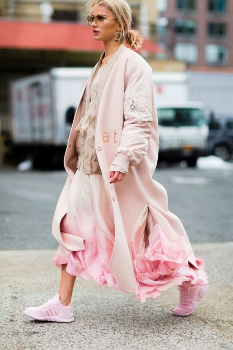 The Best Street Style From New York Fashion Week NYFW Street Style - pink all over - pink Adidas, pink over coat, pink rifled skirt, beige sweater. You NEED to wear pink this spring