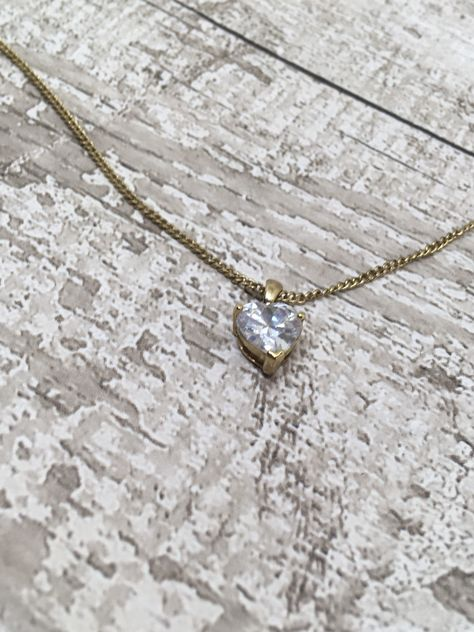 A cute little heart pendant . Featuring a central clear heart diamante . Suspended on a gold tone chain measuring 42 cm long with a 5 cm extender . All of our items are vintage and therefore pre-owned we will point out any major flaws in our listings but please be aware that vintage items often have little manufacturing quirks that are rarely seen in today's perfect production processes. If you have any questions or need specific dimensions, extra pictures of a particular detail etc please feel